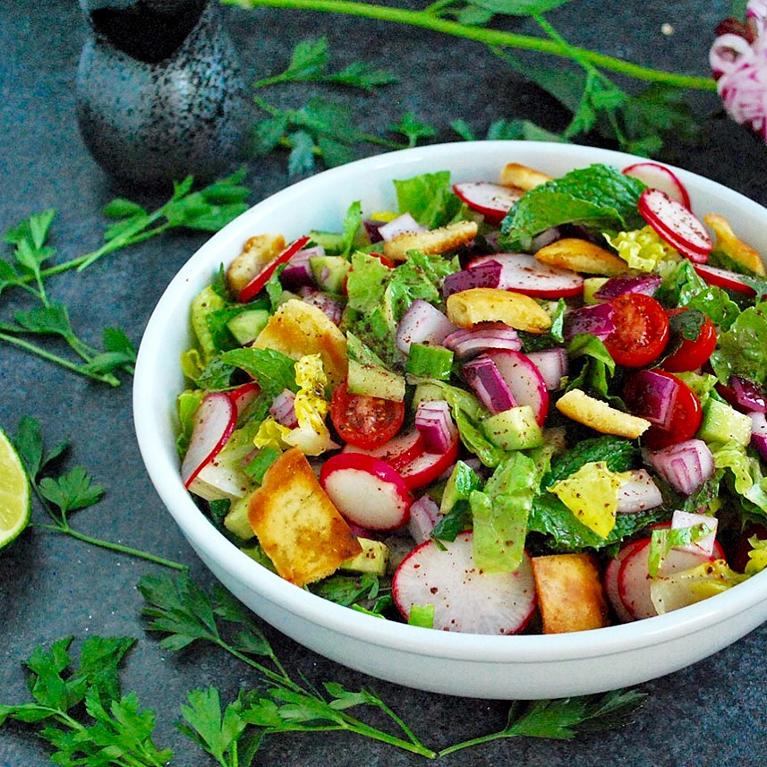 Fattoush is a vegan salad that is a staple on Middle Eastern dinner tables. Crunchy pita bread croutons, flavorful veggies and a tangy sumac dressing!