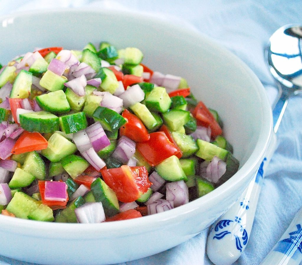 Salad Shirazi is a simple, colorful salad of cucumbers, tomato and onion which is a staple of Persian cuisine! Vegan and gluten free.