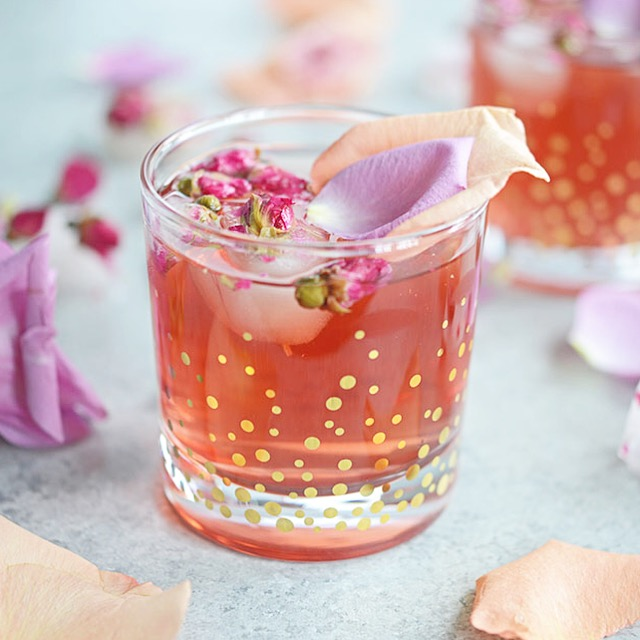 This Pomegranate Rose Gin Fizz is a gin-based cocktail with pomegranate juice, club soda and a splash of rosewater for a lovely pink, Persian-inspired drink.