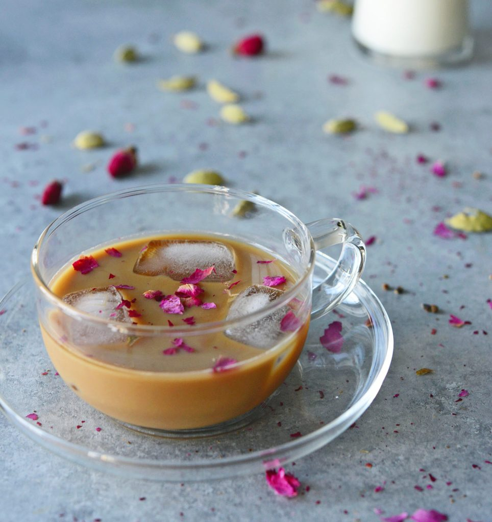 Cardamom rose iced coffee - the warmth of cardamom spice and the floral notes of rose meet in this earthy, delicate Persian-style coffee cocktail.